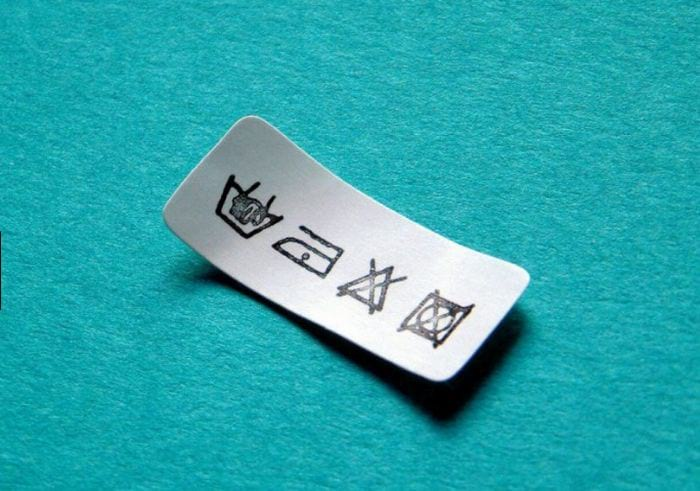 Расшифровка знаков стирки и глажки на одежде